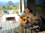 Jim Cook at his house in Thailand.  Still trying to learn to play the guitar